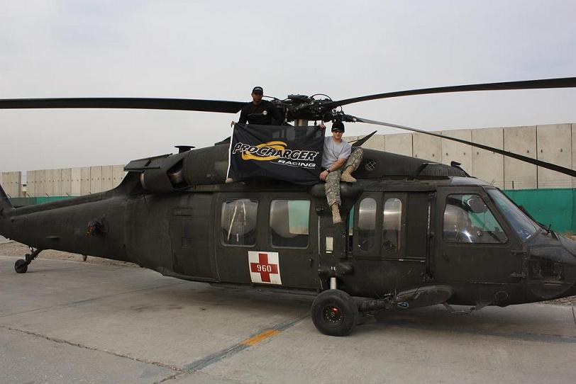 Me and one of my guys on my bird in Afghanistan.